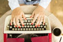 Girl Typing On The Old Typewri...