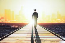 Businessman Walking On A Strai...