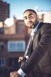 Confident attractive Arab businessman in urban environment