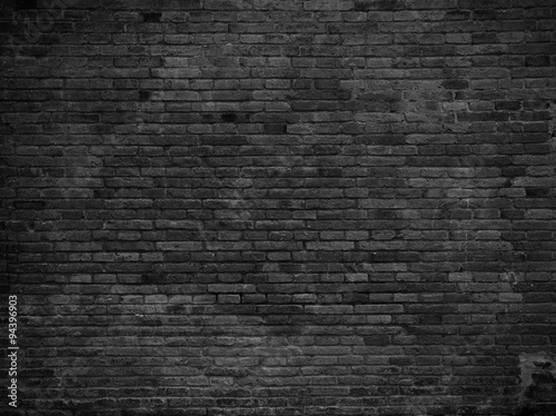 Poster Brick wall Part of black painted brick wall. Empty