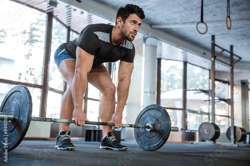 Fotografie, Obraz  Athlet lifting barbell