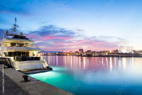 Fotografia, Obraz  Sunset in the port of Malaga city