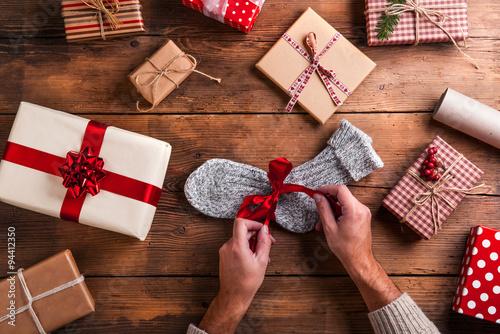 Valokuva  Man holding Christmas presents