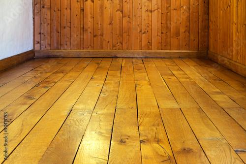 Fototapeta Old varnished wooden floor and wall of  room obraz na płótnie