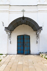 Old forged church door colored in blue.