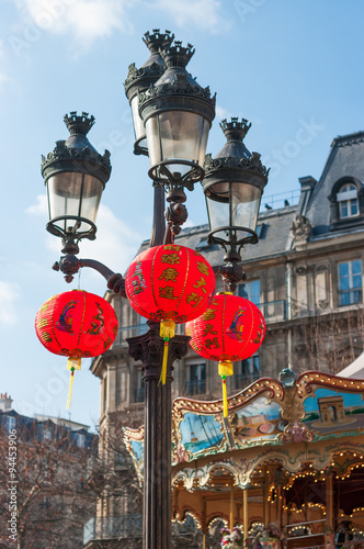 Recess Fitting Imagination Chinese lanterns hanging on lamppost with a carousel in the background for the chinese new year festivities in Paris, France.