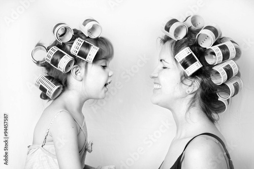 Fotografie, Obraz  vintage image of a mother and daughter wearing rollers in their hair and having