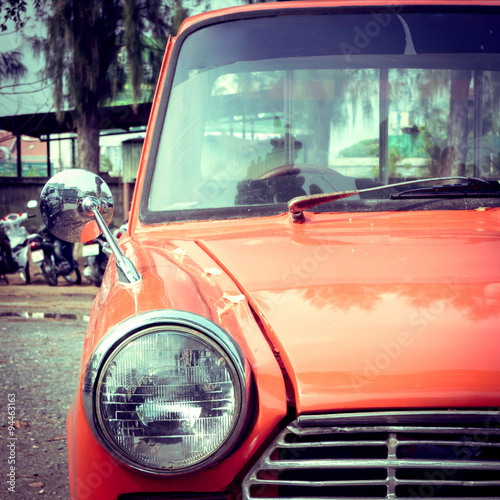 fototapeta na drzwi i meble close-up headlight of colourful classic car