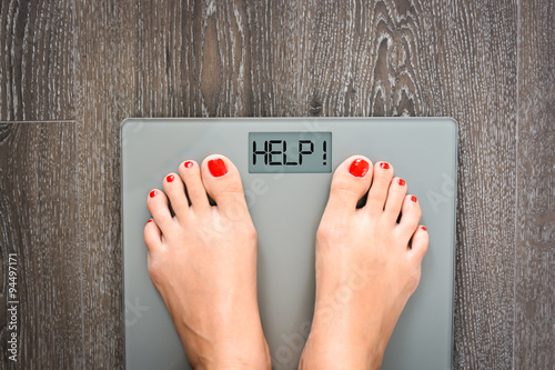 Lose weight concept with person on a scale measuring kilograms Wallpaper Mural