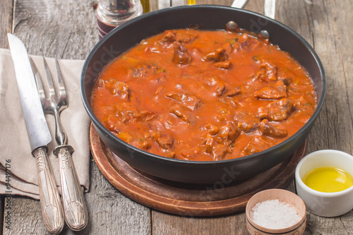 Photo Beef stew with tomato sauce