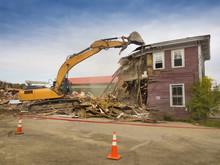 A Digger Demolishing A House F...