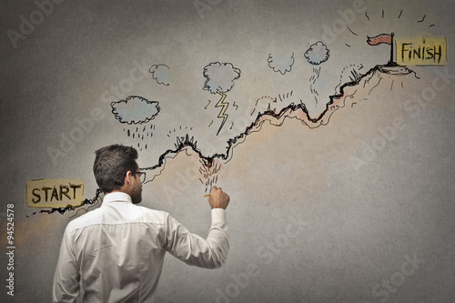 Businessman trying to reach his target Poster