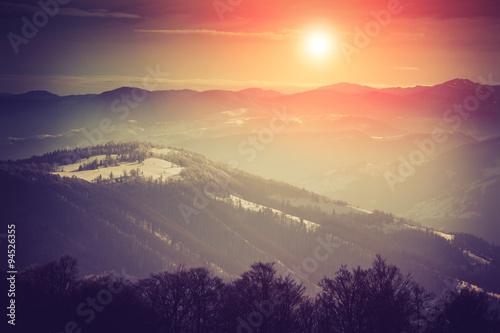 Foto op Plexiglas Crimson Mountain winter landscape. Fantastic evening glowing by sunlight.