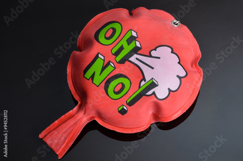 Fotografia, Obraz  red whoopee cushion with reflection on black glass