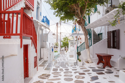 obraz PCV Mykonos town streetview with tree and red banisters, Mykonos town, Greece