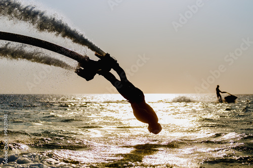 Cadres-photo bureau Nautique motorise Silhouette of a fly board rider