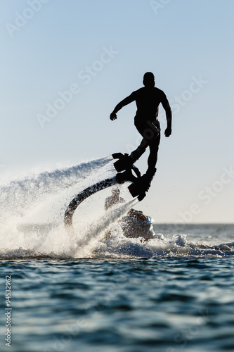 La pose en embrasure Nautique motorise Silhouette of a fly board rider