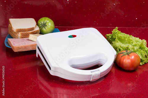 Sandwich Toaster with ingredients in a kitchen setting