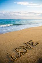 Word Love Written In Sand On T...