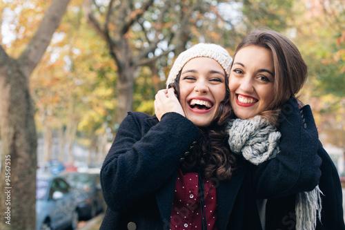 Fotografie, Tablou  Best friend girls huggging outdoors