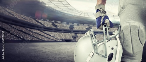 Close-up of american football player holding helmet Wallpaper Mural