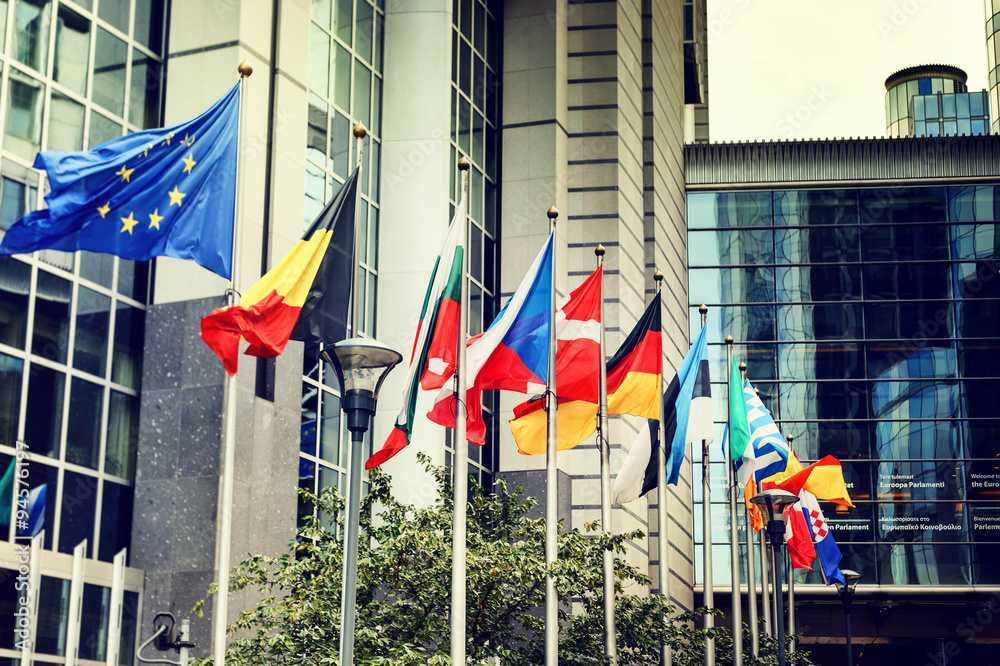 Fototapety, obrazy: Waving flags in front of European Parliament building in Brussel