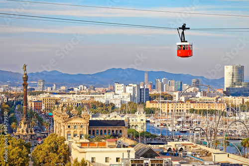In de dag Barcelona Red cabin of cableway stands out on Barcelona's port