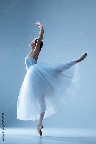 Fotografie, Obraz  Portrait of the ballerina on blue background