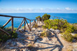 Wooden railing on rocky sea coast