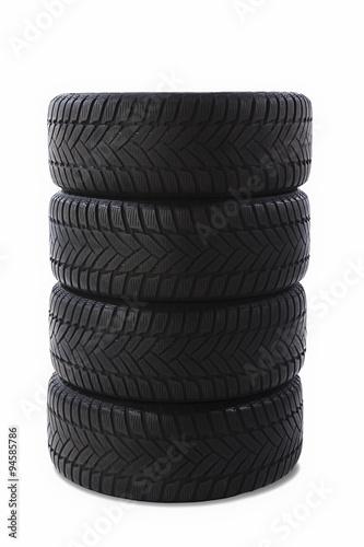 Fotografia, Obraz  Gestapelte Winter Reifen isoliert auf weiss