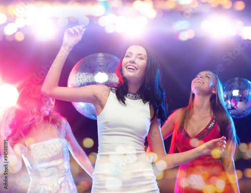 obraz lub plakat happy women dancing at night club
