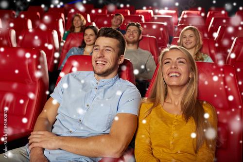 Fotografija  happy couple watching movie in theater