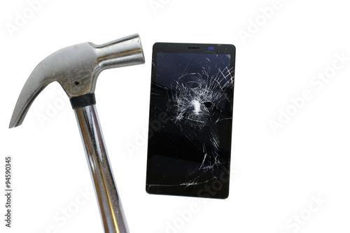 Fotografie, Obraz  Hammer hit broken screen cell phone isolated on white background