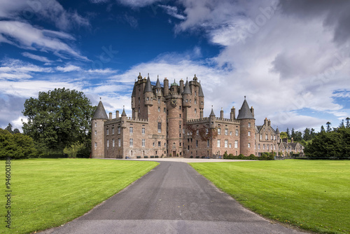 Wall Murals Castle View of Glamis Castle in Scotland, United Kingdom. Glamis Castle is situated beside the village of Glamis in Angus. It is the home of the Countess of Strathmore and Kinghorne, and is open to public.
