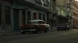 Vintage cars driving on an old Havana street