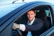 rent a car, smiling happy caucasian young man driving