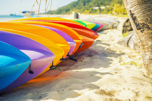 Row Of Colorful Kayaks At Sea Shore On Tangalooma Island, Queensland.