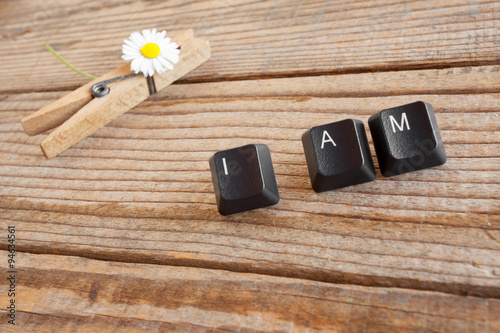 Fotografia, Obraz  I AM wrote with keyboard keys on wooden background