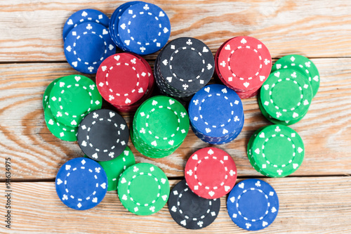 Poker chips over wooden background плакат