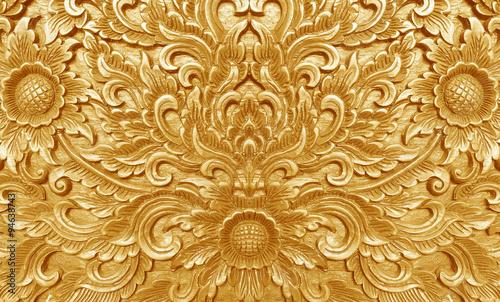 Valokuva  Ancient golden carving wooden door of Thai temple. Thailand