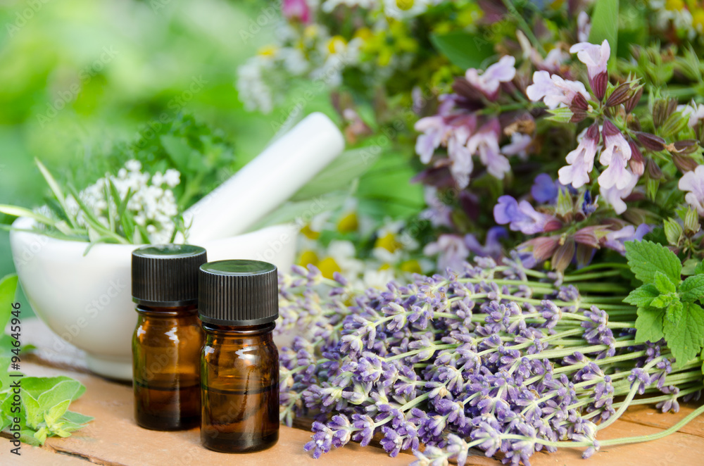 Fototapety, obrazy: essential oils with herbal flowers for aromatherapy treatment