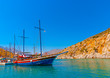canvas print picture traditional wooden big sailing boat  docked at the port of Vathi village in Kalymnos island in Greece