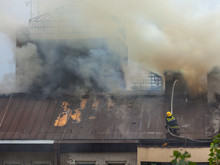 Firefighter At Work On Extinguishing The Fire On Roof