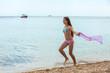 Happy teen girl having fun on a beach