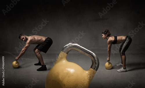 personal trainer and student with kettleball