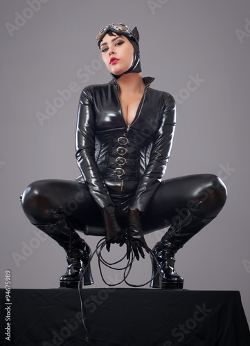 Canvas Print catwoman / Beautiful woman in catwoman leather latex whith whip