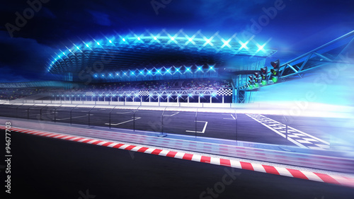 Recess Fitting F1 finish line gate on racetrack with stadium in motion blur