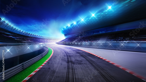 Ingelijste posters F1 racecourse bended road with stands and spotlights