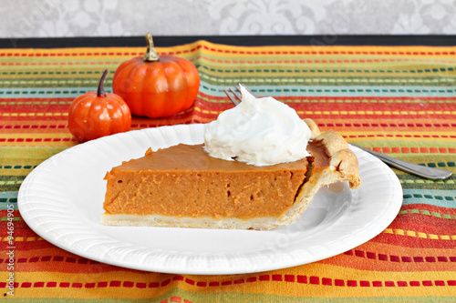 Fotografia, Obraz  Pumpkin pie slice with whipped cream.