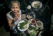 Senior Woman Chef Cooks In The Kitchen